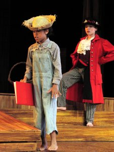 Autumn Smith (left, as Nephew), with Jessica Nieves (as Bilbo Baggins) in The Hobbit, 2004.