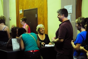 Sue Stewart, our friendly Volunteer Coordinator (shown here at the center of box-office action during the 2012 production of Rent) will sign you up to help in one of many ways.