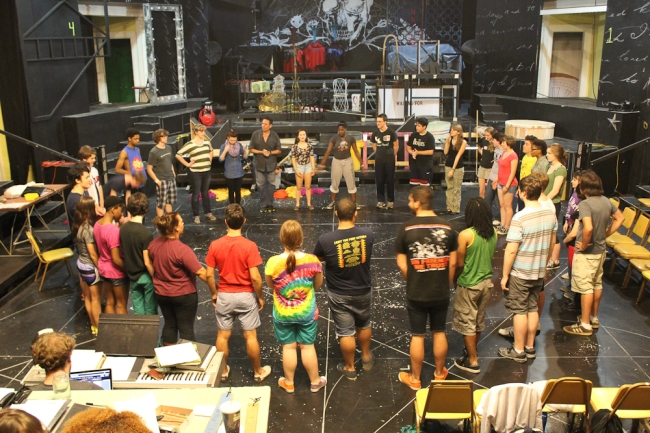 The cast of Side Show circles up with Director Bob Navis Jr. (hands folded) at a June 2013 rehearsal.