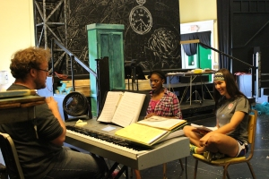 (From left) Musical Director Jordan Cooper works with Side Show twins CoCo Smith and Erin Sheplavy at a June 2013 rehearsal.