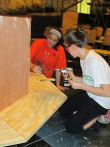Two participants work on a set piece together Photo by: Devin Sweeney