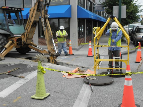 A Cleveland Public Power crew on Sept. 3 works with underground cables at  W. 67th St. and Detroit Ave. that feed the Gordon Square Arcade Building and eventually will serve the new Near West Theatre.