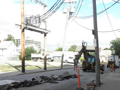 A worker jackhammers West 67th Street on Sept. 16 to make way for new underground cables.