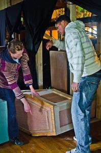 Molly Andrews-Hinders and Jason Dugger worked on a coffin and other set pieces at the 2011 Community Work Day. Photos by Mo Eutazia.