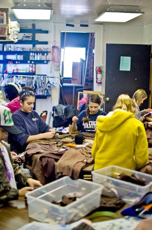 Roxy Reminick (left) and Katie Medvec (center) were on patch-sewing, costume-organizing duty in 2011.