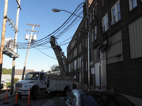 Aerial cables across West 67th Street connected the transformers on the west side of the street to the Gordon Square Arcade Building on the east side.
