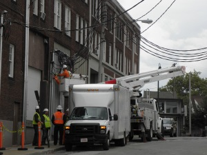 A Cleveland Public Power Crew works on existing cables on the west end of the Gordon Square Arcade Building on Oct. 17. Photos by Hans Holznagel