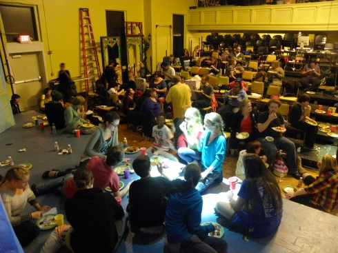 Cast, crew and staff take nourishment on stage and in the house.