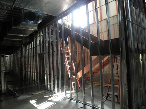 One of two sets of stairs connecting lower level, lobby and balcony was being installed Aug. 20.