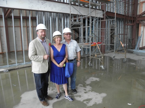 Jason Bristol, president of NWT Board of Trustees, and donors Char and Chuck Fowler pause of an upstage-center picture Aug. 21 on recently completed concrete.