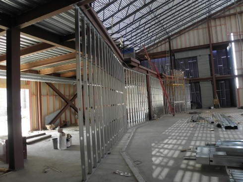 The back wall separating the auditorium from the lobby was becoming visible in this Aug. 25 photo.