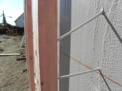 "Especially long screws connect wood batten to ""dense board"" sheathing that has been coated with a ""fluid-applied air barrier."""