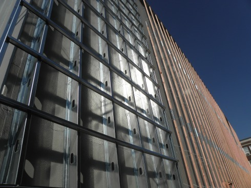 The south wall, awaiting further layers, catches the afternoon sun.