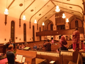 Musical Director Ian LeRoy (left) and Director Bob Navis Jr. (lower center) work with actors already using the first of temporary platforms.