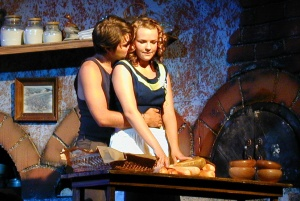 Katie Klaus with Alex Nosse in The Baker's Wife (2002). Photo by Rob Sommerfelt.