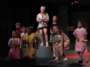 Autumn (right) belting it out with the Snoopy cast in 2003.
